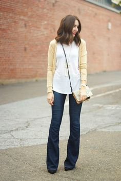 Love the simplicity of this. Dark wash flared jeans, white tee, soft yellow cardigan, black boots
