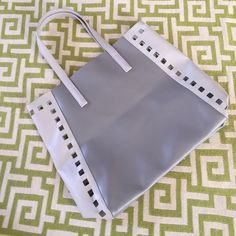 "NWOT Estée Lauder Ltd. Ed. Tote Bag NWOT Estée Lauder Ltd. Ed. Tote Bag. Gorgeous two tone grey leather like material this bag is strong and will hold books or your laptop or tablet and just about anything else you need to carry. 17"" wide x 13.5"" tall. Shoulder strap to bag is 8 inches. Beautiful. Estee Lauder Bags Totes"