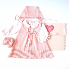 A knitted baby dress with cap and little shoes in by tenderblue.