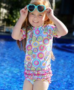 Why settle for typical when you can have, fun, frilly and funky?!? Certain to stand-out, she'll be sporting the most stylish sun protection around!