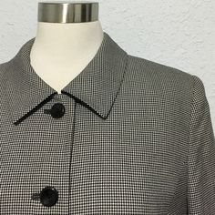 Vintage: Checkered black & white button up blazer This beautifully detailed blazer can be worn to the office, or as a jacket on a night out. In great condition for a vintage piece. No rips or stains. Nicely shaped shoulder pads adds a touch of style. A tiny side button and elastic loop shown in the second photo, hold the top flap down for a more polished look. Has front side slits and a comfortable lining for all day wear. Can easily be dressed up or down, by pairing it up with a skirt…