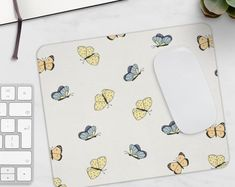 Stain-resistant and easy to clean, this cute mouse pad is the perfect desk accessory! #mousepad #butterflies #cute