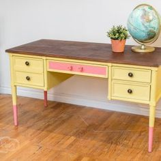 Mid-Century Thomasville Desk:   The base has been painted in a custom colored paint finish using Annie Sloan Chalk Paint®. The color combination for the warm yellow shade is a mix of English Yellow and Cream while the coral pink shade mixes Barcelona Orange with Scandinavian Pink. Made of solid wood with dove-tailed drawers. The top has been refinished in a rich, dark wood finish to display the parquet wood design.  #yellowdesk #yellowfurniture #midcenturyfurniture #midcentury #ChalkPaint