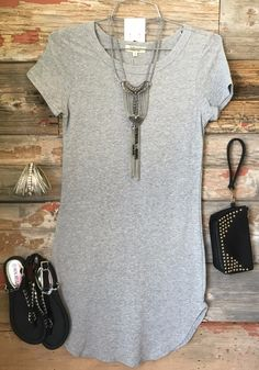 The Fun in the Sun Tunic Dress in Heather Grey is comfy, fitted, and oh so fabulous! A great basic that can be dressed up or down! (www.privityboutique.com) #privityboutique #fun #sun #heathergrey #fitted #tunic #dress
