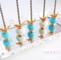 Blue and white cake pops with gold crown