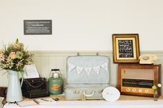 Lots of fab vintage props for their gift table, including a typewriter and antique radio.    Wigginton Church & Hastoe Village Hall Wedding