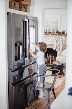 Life and style blogger Lauren McBride shares her Samsung Family Hub 2.0 review and the features available to make this fridge stand out about the rest. #ad