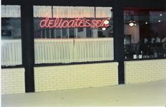 One of our storefronts from the 1980s. Gotta love those sweet curtains!
