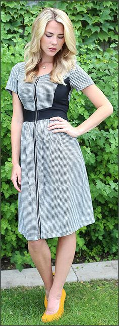 The Stella Dress in Dark Grey featuring a front zipper detail, (perfect for nursing mom's) The contrast waist will give the illusion of a smaller waistline. Get is now for $39.75! Don't forget to use coupon code GrandOpening to get 25% off your order.