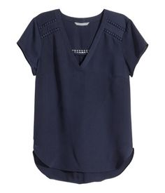 Short-sleeved, V-neck blouse in airy woven fabric with lace trim inserts and a gently rounded hem. Slightly longer at back.