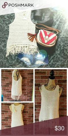 """Boho Gypsy Creme Fringe Tank Thick yarn with stripe texture.  Fringe along bottom hem.  100% cotton.  High low  Measurements are taken laying flat and are approximate. S- bust: 19"""" bottom: 23"""" length: 22"""" front/26"""" back M- bust: 20"""" bottom: 26"""" length: 24"""" front/27"""" back L- bust: 21"""" bottom: 28"""" length: 25"""" front/28"""" back  Price firm unless bundled.  #100518 posh on first boutique  Tops Tank Tops"""