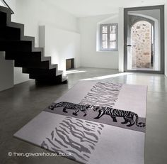 Tiger Rug, a luxury grey, black & cream hand-tufted wool & viscose tiger themed rug http://www.therugswarehouse.co.uk/modern-rugs3/kalahari-rugs/tiger-rug.html #rugs #interiors