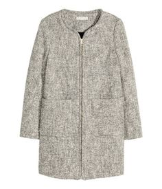 Melange herringbone-patterned coat in a cotton blend with wool content. Concealed zip and patch pockets at front. Lined.