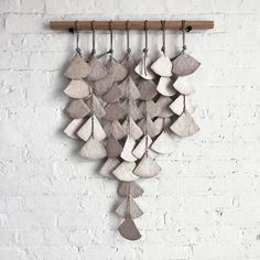 7 strands of stoneware White Shell discs knotted together with hemp twine and assembled on hemp rope Hung on either Walnut or White Oak beveled wood bar Measures approximately x Wall Mounts not included. Mounting hardware is available here Handmade in NYC Clay Wall Art, Ceramic Wall Art, Clay Crafts For Kids, Clay Supplies, Deco Nature, Clay Art Projects, Clay Ornaments, Paperclay, Pottery Designs