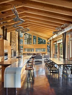 Contemporary kitchen features exposed joists and polished concrete floors…