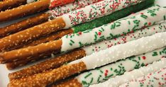 White Chocolate-Dipped Pretzel Rods  gets all dressed up for Christmas with the help of beautiful holiday sprinkles!  Or, change the sprink...