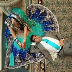 indian wedding bride in blue green lengha