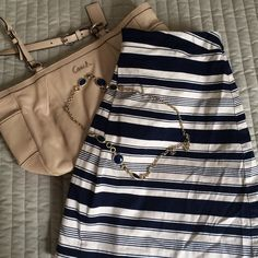 Navy and tan stripe skirt Navy and tan stripe skirt.  Accessories not included, but listed separately.  Comes from a pet-free, smoke-free home. Skirts