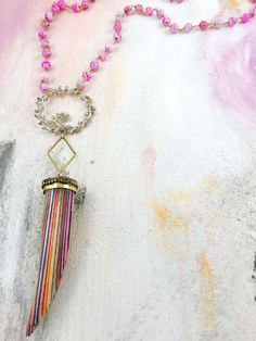 """Lucky Go Happy"" - 1950's rhinestone floral brooch paired with a rainbow horn pendant on pink jade beaded chain"