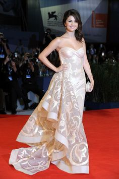 Selena Gomez is absolutely stunning in an Atelier Versace gown at the premiere of her new film Spring Breakers at the 69th Annual Venice Film Festival.
