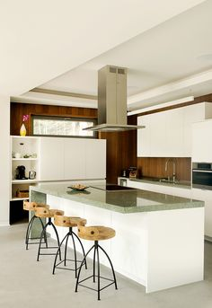 Contemporary kitchen in a retreat on the shores of Gate Lake, by Eric Joseph Tremblay.