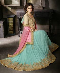 This Lehenga saree is a true creation of all patterns and designs that you will love. A little bit of this and a little bit of that but with a whole lot of gorgeousness, this saree is perfectly printed in lovely Net Georgette. Perfect warm night out, the butta embroidery, zardosi and patchwork on the border will further accentuate the style of the saree and yours too! Go flaunt it with a superb pattern with your matching blouse that comes along with this drape.