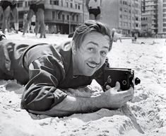 Walt filming a beach, probably on his 1940 South American tour.