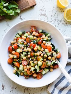 This simple chickpea salad recipe is my go-to when the weather turns warm. It goes with everything off the grill, tastes even better as leftovers, and can even be a simple lunch all on its own!