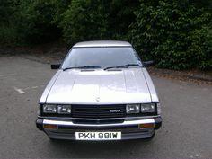 "Dream car! 1981 Toyota Celica ST coupe (black w/white 17"" wheels, lowered, '79 Supra rear-end)"