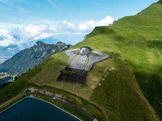 French Artist, Saype, Creates the World's Largest Biodegradable Painting on Grass