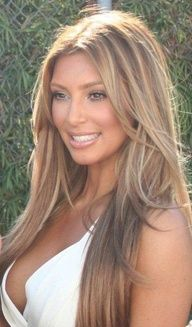 tone down the blonde a little  and go for an all over mousy brown with blonde highlights