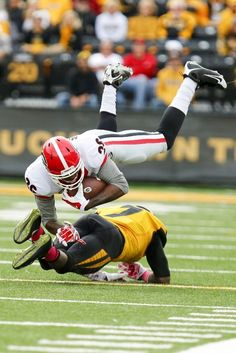 Georgia Football - Bulldogs Photos - ESPNCOLUMBIA, MO - OCTOBER 11: Malcolm Mitchell #26 of the Georgia Bulldogs has his feat taken out by Kenya Dennis #7 of the Missouri Tigers early in the second quarter on October 11, 2014 at Faurot Field/Memorial Stadium in Columbia, Missouri. (Photo by Kyle Rivas/Getty Images)