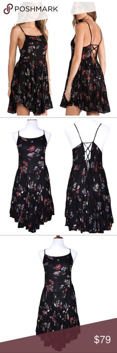 Free People Circle of Flowers Corset Skater Dress Free People floral slip dress. Black with light red and light purple floral print, spaghetti straps, adjustable corset ties in back with very flowy tiered gypsy V hemline skirting. Wear this year round with a cardigan sweater and boots on cool days or by itself on warm days, this is a beautiful classic must have go-to piece for every closet. Very good condition. Free People Dresses Midi