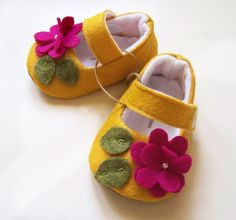Yellow baby girls shoes, flower baby booties, felt baby shoes, pink flower booties. $34.00, via Etsy.