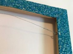 hanging - note screw eyes inside frame to hang on wall from an attached wire. It's a way to achieve a framed effect without glass. Quilting Frames, Quilting Tips, Quilting Tutorials, Quilting Projects, Art Quilting, Hanging Quilts, Quilted Wall Hangings, Hanging Art, Sewing Binding