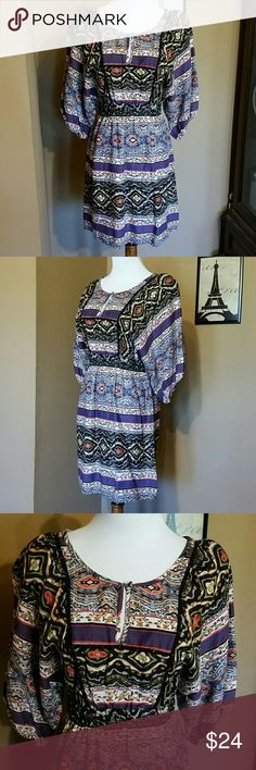 Long sleeved, fun patterned dress I can't measure armpit to armpit, because the sleeves are wide open. But I can measure the ELASTIC waist which is 12 inches flat. Shoulder to hem is 34 inches Jessica Simpson Dresses