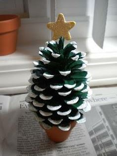 paint pinecone green.  add white paint on the tips, add a star and glue into a mini flower pot.
