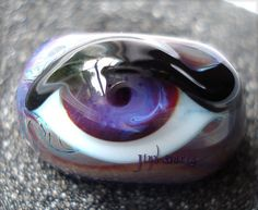 Purple and Brown Glass Evil Eye Bead by Jinx Garza.