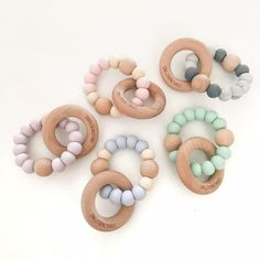 SINGLE RATTLE teethers combine a soft, chewable silicone teething ring to soothe sore gums and hard, natural beech wood teething ring for extra relief for teething babies and beech wood beads for rattle, sound and texture. Modern, on-trend teething baby essentials from one.chew.three