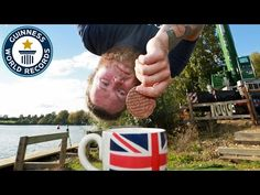 A man has bungee jumped 70 metres to dunk a biscuit into a cup of tea and claimed the Guinness World Record for Highest bungee dunk. Report by Sarah Duffy.