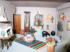 The dollhouse shell was purchased unfinished in Fredericksburg and immediately suggested a Southwestern Store.