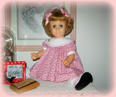 My blue pinwheel eyed Chatty Cathy in a baby doll dress.