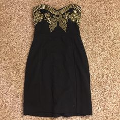 Strapless mini dress with gold detailing Never worn, super fitting. Got from local boutique Dresses Mini