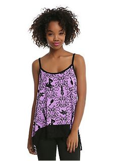 """<div>Make all your fashion dreams come true with this purple tank top from Disney's <i>Tangled</i>. The crisscrossed strappy tank top has an allover vine print intermixed with iconic images from the animated classic.</div><div><ul><li style=""""list-style-position: inside !important; list-style-type: disc !important"""">95% rayon; 5% spandex</li><li style=""""list-style-position: inside !important;..."""
