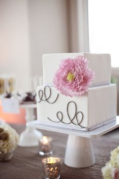 cake top for 1 year anniversary and cake to cut at the wedding then get cupcakes for the rest of the guests