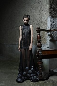 Malgorzata Dudek spring/summer 2012 - sombre, intricate sheer black dress, lower edge of skulls? baby heads? doll heads? Creepy but elegant