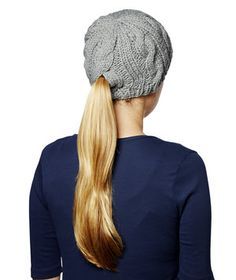 Hidden openings in this cozy wool hat keep your head warm and your ponytail in place.