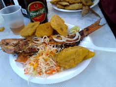 Haitian food! Prestige, fried plantains, and pikliz, so delicious