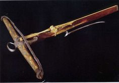 "Crossbow Origin Southern Germany, about 1475 Materials Wood; painted parchment; cord; bone; horn; iron; modern leather Measure 28 1/4"" L x 27 1/2"" W Weight 7 lb. 14 oz."