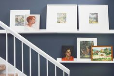 Shelving for pictures on a staircase instead of hanging them directly on the wall